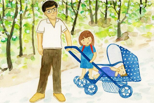 子どもと散歩する父親