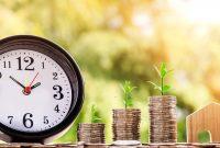 時計、お金、コイン、家の模型